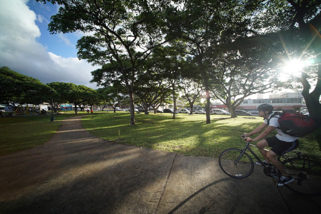 Cyclist rides through Old Stadium Park after city reopened the park.