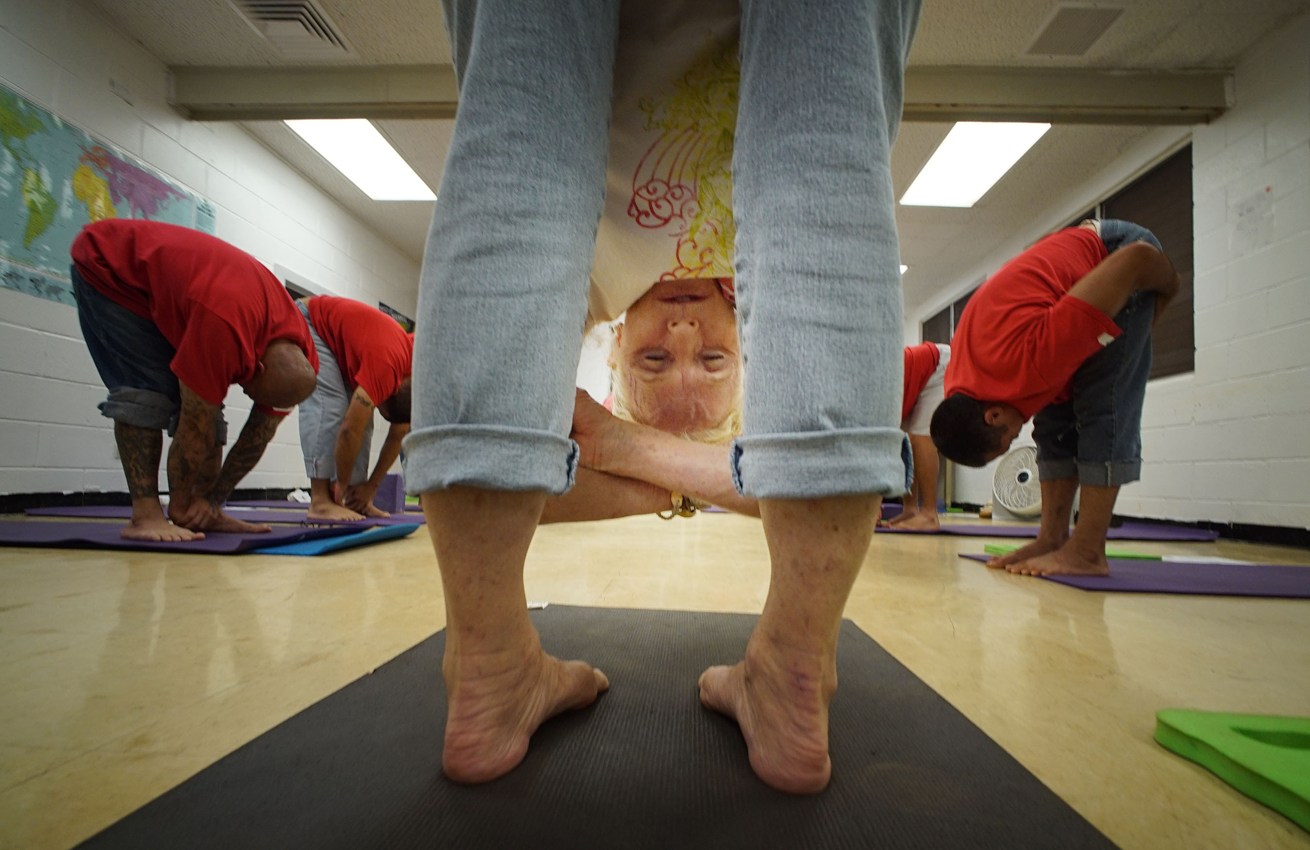 Yoga Teacher Lu DiGrazia teaches a class in the Waiawa Prison, Malamama Center.