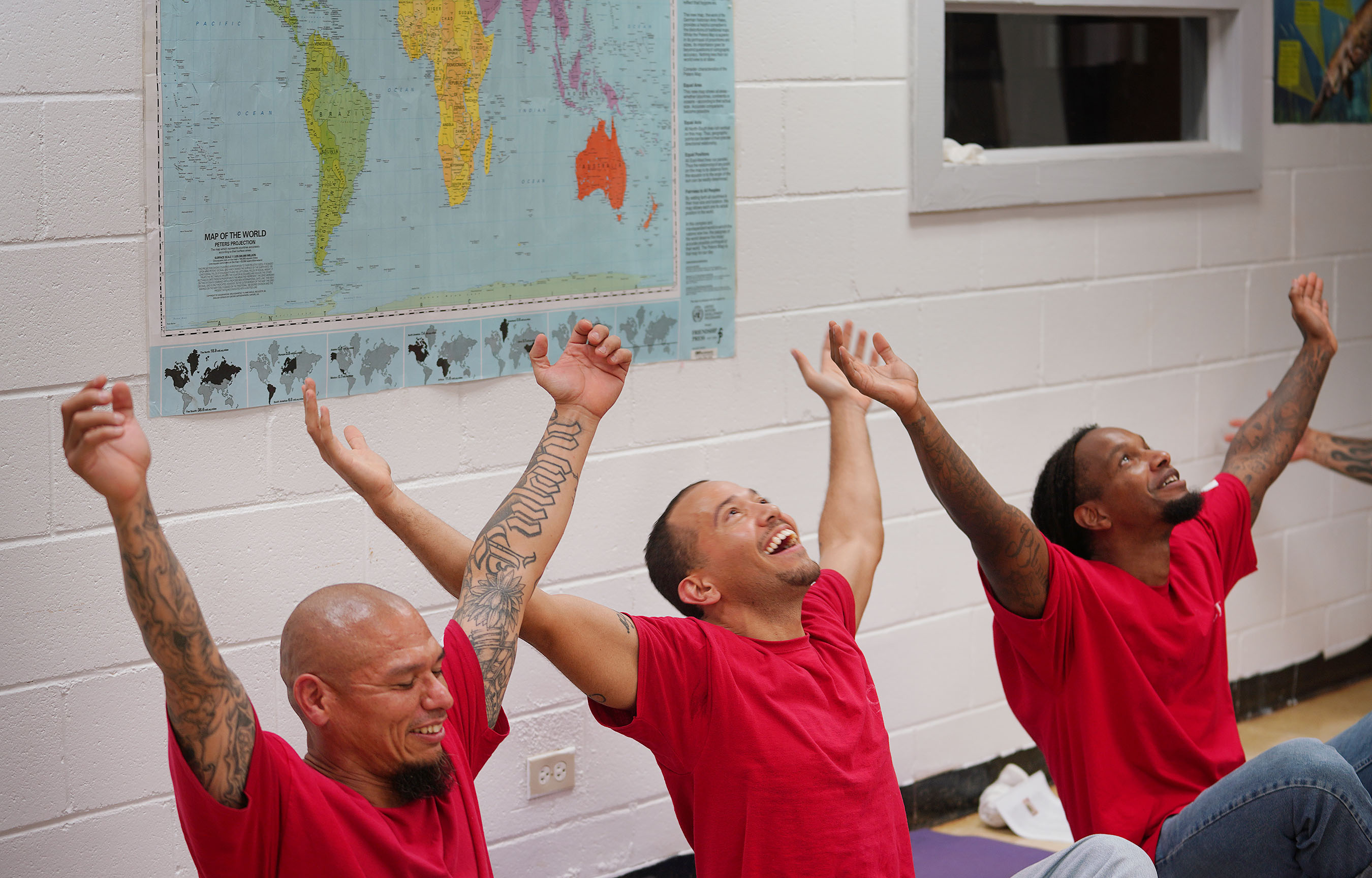Waiawa Prison, Hale Malamama with left to right, William Brooks, Dante Rackley and right, Brendan Hill laugh during the 'happy pose'.