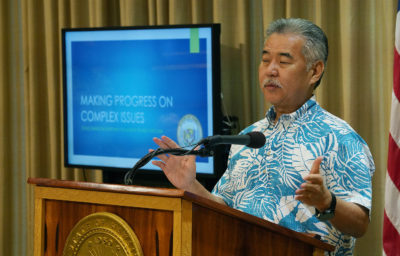 Governor David Ige gestures during press conference announcing his administration's budget for the upcoming fiscal year.