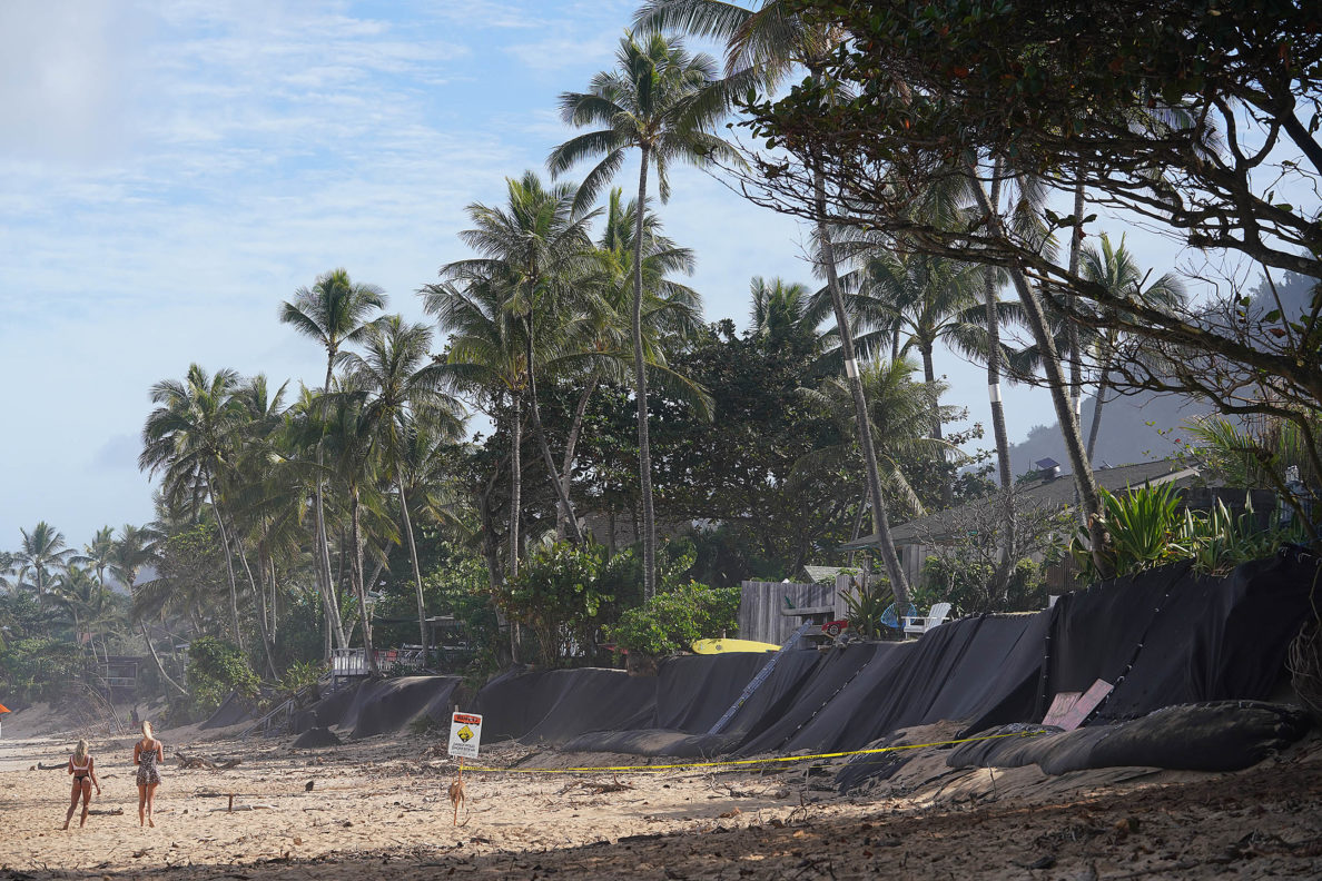 Beach front properties near Ehukai Beach with black material to protect erosion.