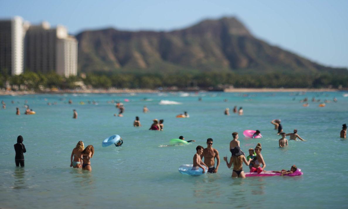 Azure blue and sandy shore of Waikiki Beach.