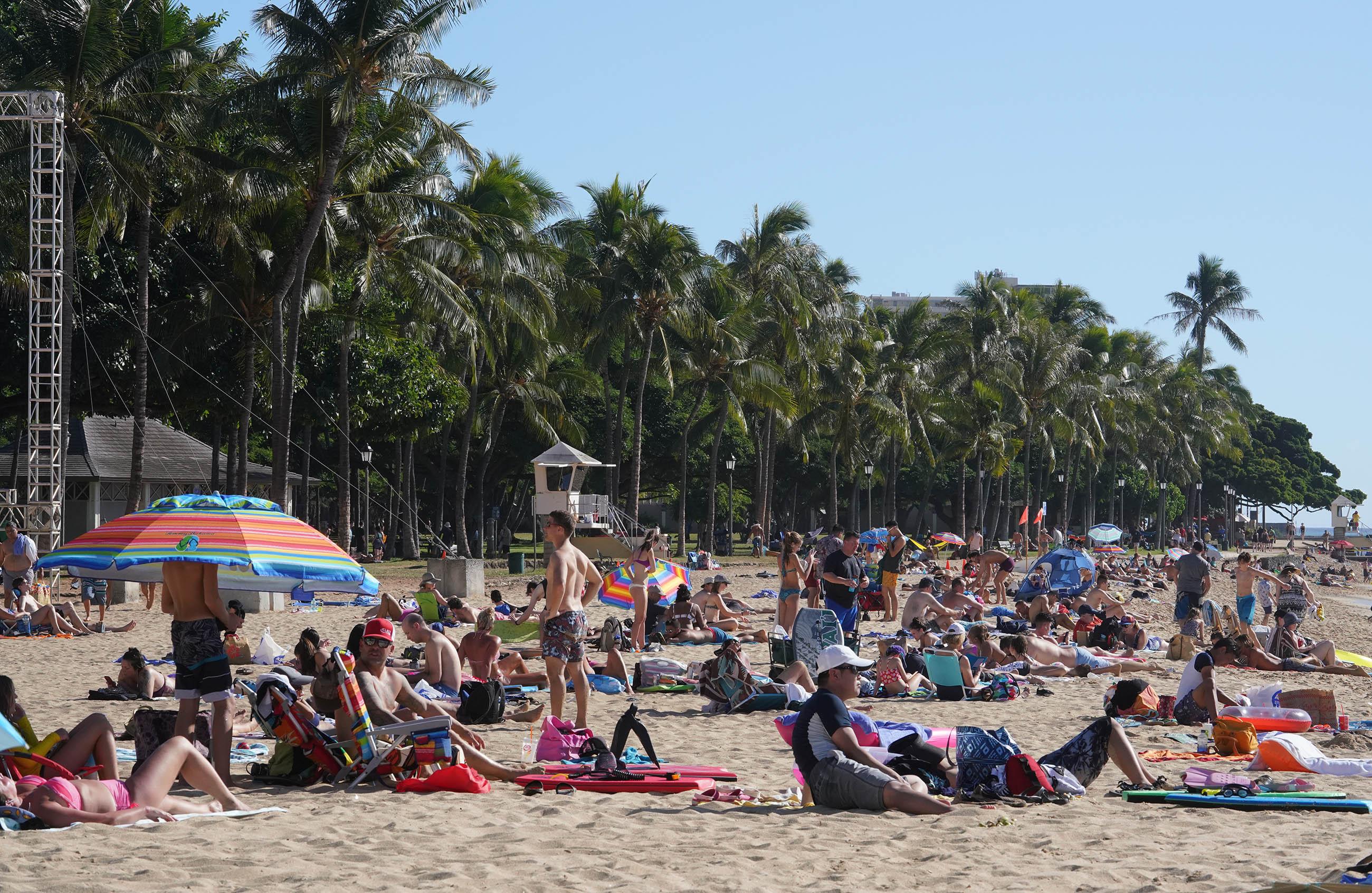 Visitors at Waikiki Beach near the Kapahulu groin.
