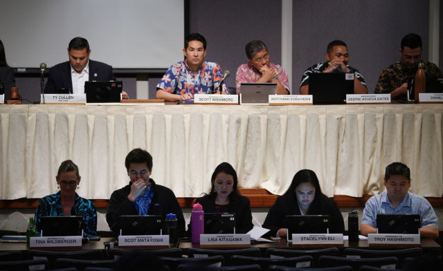 Below, some of the newly elected Representatives sit during a joint Committee on Ways and Means and Committee on Finance informational meeting held at the Capitol Auditorium.