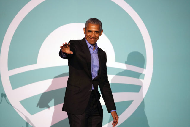 President Barack Obama waves to audience after foundation speech at the East West Center.