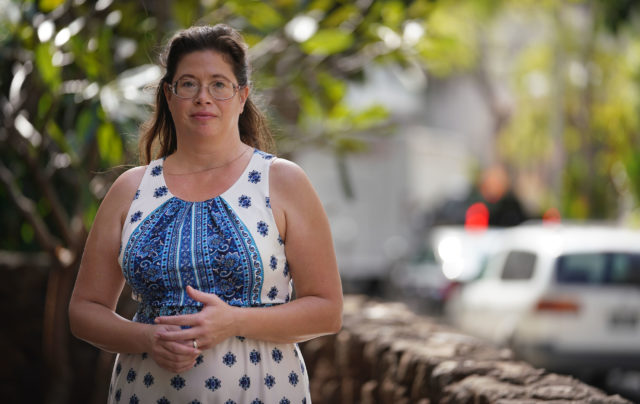 Government Shutdown. Michelle Baker stands near her condominium in Waikiki.