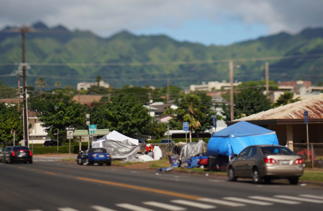 Homeless Street Dwellers tents along Isenberg Street in Moiliili with Manoa as a backdrop.