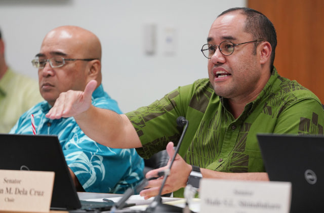 Finance Chair Senator Donovan Dela Cruz asks OHA Ka Pouhana Kamanaopono Crabbe some questions during hearing.