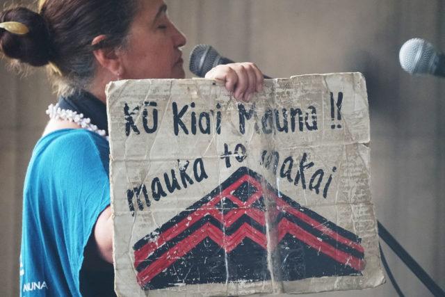 Mauna Kea speaker on opening day of the 2019 Legislature speaks in the rotunda.