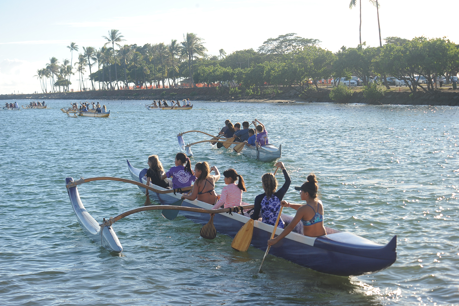 <p>Youth paddling team members practice three times a week at Magic Island.</p>