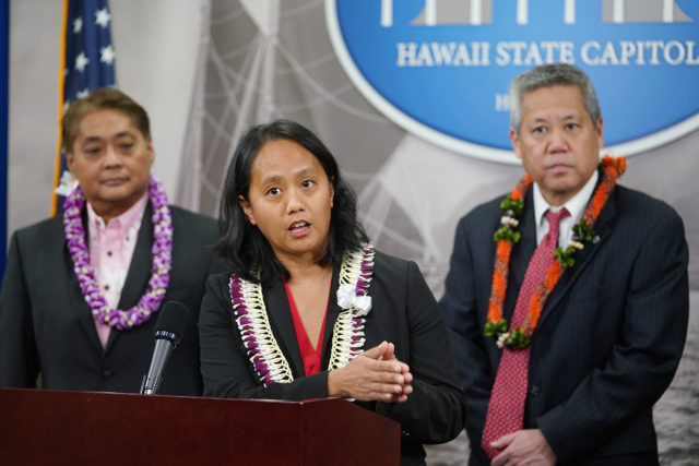 Rep Della Au Belatti speaks flanked by Speaker Scott Scott Saiki and left, Rep Nakashima at a press conference  held after Governor Ige's state of the state address.