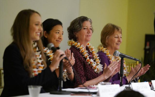 Left to right, Rep Lauren Matsumoto, Rep Linda Ichiyama, Senator Laura Thielen and right, Senator Rosalyn Baker cheer clap during the 2019 Hawaii Womens Legislative Caucus Breakfast held at the YWCA.