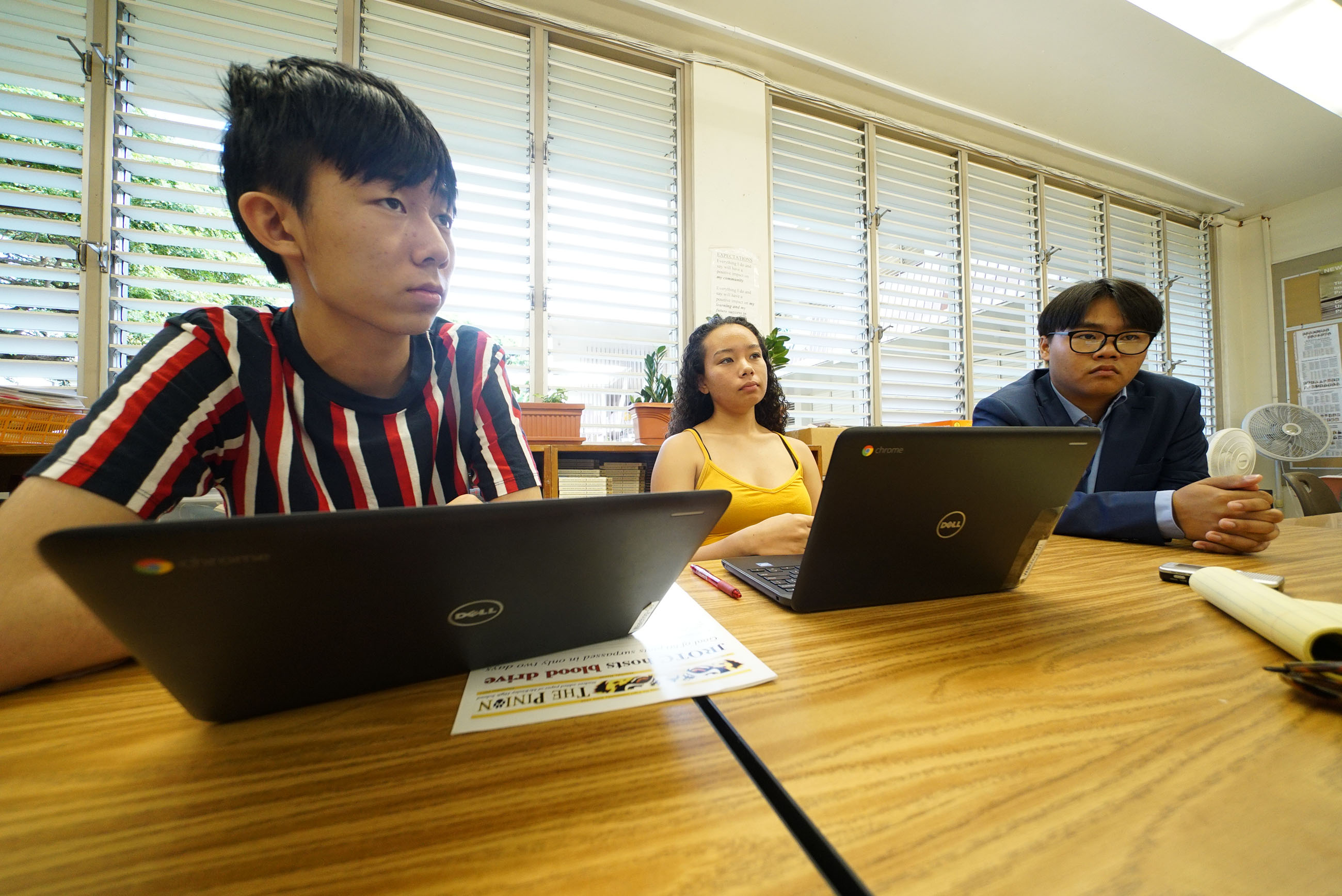 L-R, 16-yr-old Kelvin Ku, 16-yr-old Alexandria Buchanan and right, 17-yr-old Thompson Wong in Cindy Reves' journalism class at McKinley High School.