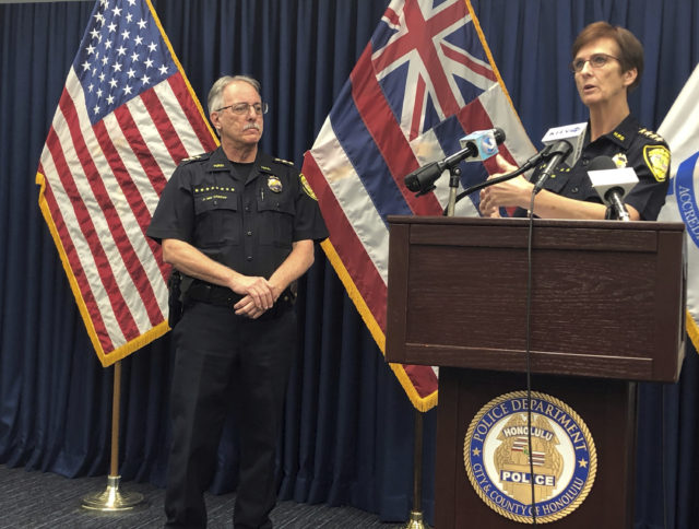 Honolulu Police Deputy Chief John McCarthy, left, listens as Honolulu Police Chief Susan Ballard, right, speaks at a news conference on Tuesday, Jan. 29, 2019, in Honolulu about a crash that killed three pedestrians. (AP Photo/Jennifer Sinco Kelleher)