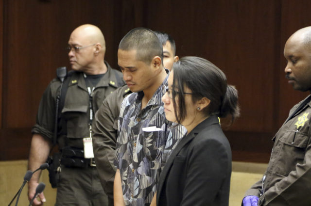 Alins Sumang stands next to Deputy Public Defender Sarah Nishioka in court Thursday, Jan. 31, 2019 in Honolulu. Prosecutors say Sumang recklessly caused the deaths of Casimir Pokorny of Pennsylvania, Reino Ikeda of Japan and William Lau of Honolulu. Police say speed and alcohol appeared to factors in Monday's crash. Police Chief Susan Ballard says it's one of Honolulu's deadliest pedestrian crashes. (AP Photo/Jennifer Sinco Kelleher).