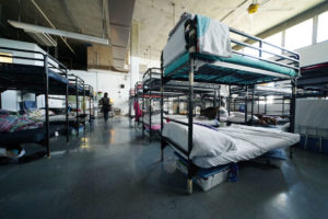 COVID-19 Outbreak Prompts Lockdown At Iwilei Homeless Shelter
