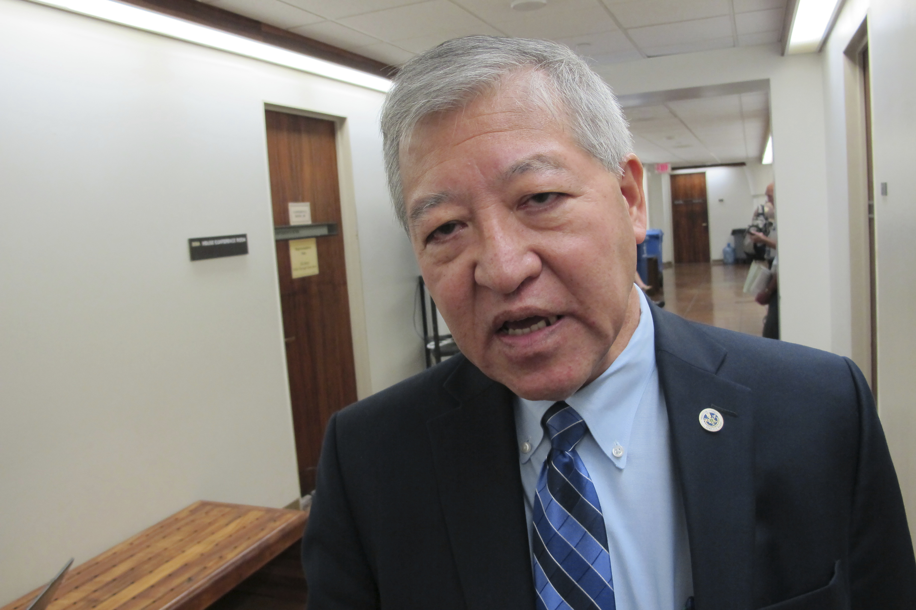 FILE - In this March 2, 2016, file photo, Honolulu's top prosecutor Keith Kaneshiro talks to The Associated Press in Honolulu. Hawaii Attorney General Clare Connors asked the state's highest court on Tuesday, Feb. 12, 2019, to immediately suspend Kaneshiro because he is the target of a federal investigation. (AP Photo/Cathy Bussewitz, File)