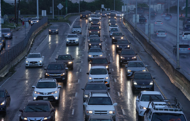 Cars head westbound on the H1 freeway.