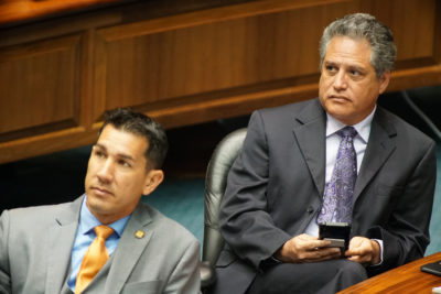 Sen J Kalani English and Sen Kai Kahele during floor session.