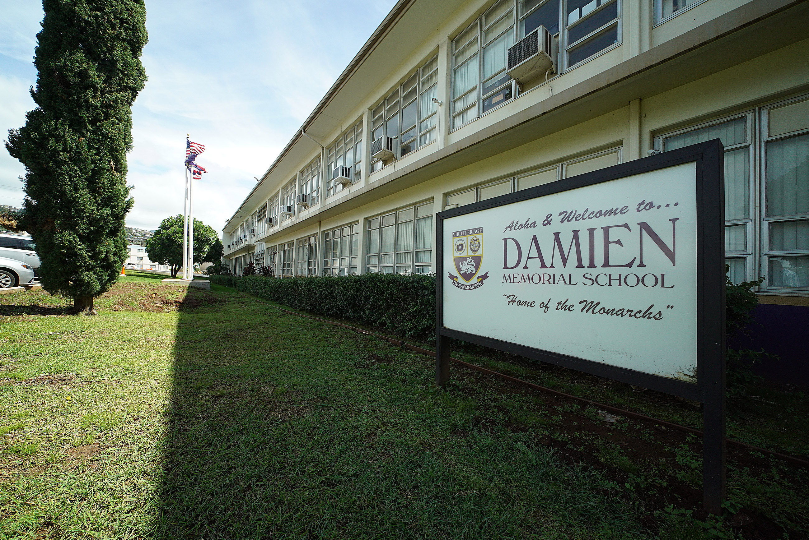 Damien School sign.