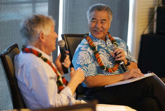 Governor David Ige chats with Neil Milner at the Plaza Club.