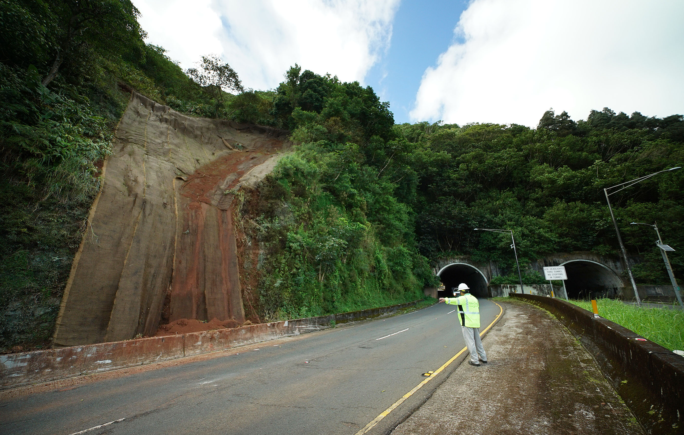 <p>The Department of Transportation wants to guard against future rockslides by installing mesh barriers, including in this area near a Kailua-bound tunnel.</p>