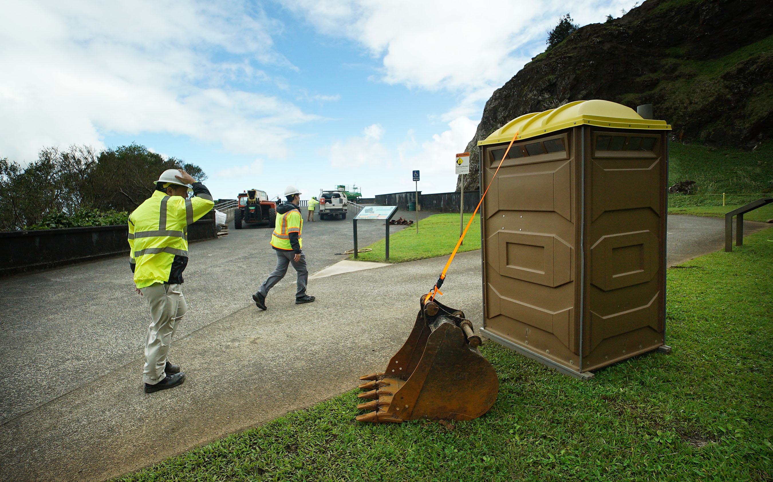<p>The winds are so strong atop the Pali Highway that workers had to get creative to anchor a portable toilet.</p>