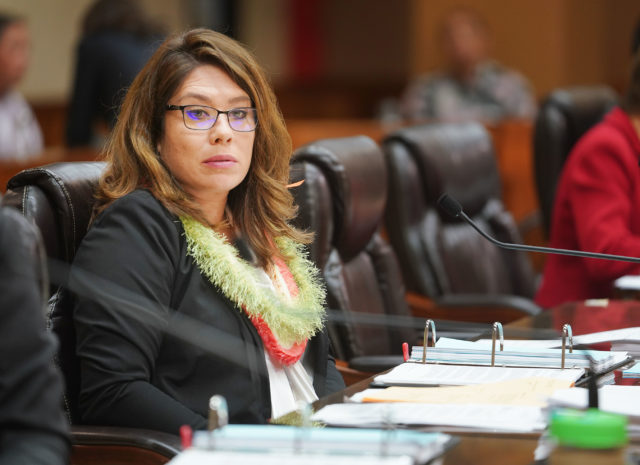 Honolulu City Council Member Heidi Tsuneyoshi listen to public testimony.