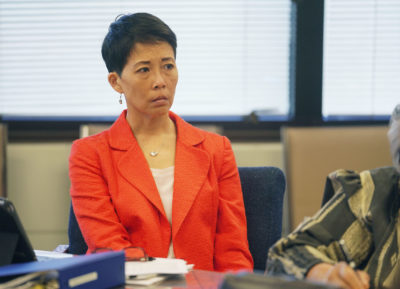 Rachael Wong listens to the Chief Justice during the Salary Commission meeting.