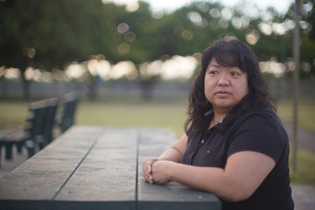 Janet Moya sits at Lehua Park in pearl City. John Hill story.