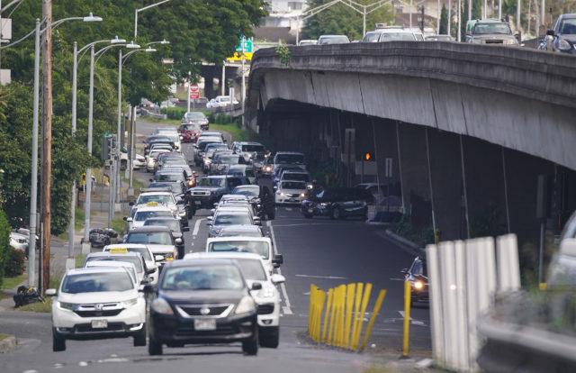 Lunalilo and Piikoi Street looking Diamond Head Direction as cars merge on the westbound onramp.