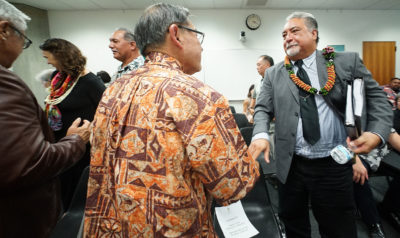 Ford Fuchigami greets Public Safety Director Noland Espinda after hearing. Senators will convene for decision making on April 11, 2019.