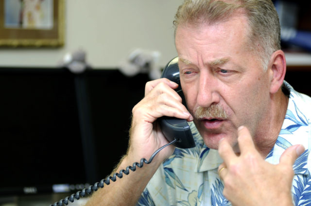 FILE - This March 11, 2011 file photo shows then-Honolulu Mayor Peter Carlisle speaking on a telephone as he worked from the Department of Emergency Management in Honolulu. Carlisle says a growing corruption investigation has made him want to return to his old job as the city's top prosecutor. Carlisle tells The Associated Press, Wednesday, April 10, 2019 he's ready to run against Honolulu Prosecuting Attorney Keith Kaneshiro, who took a leave of absence after receiving a letter informing him he's a target in a federal investigation. (AP Photo/Rebecca Breyer)