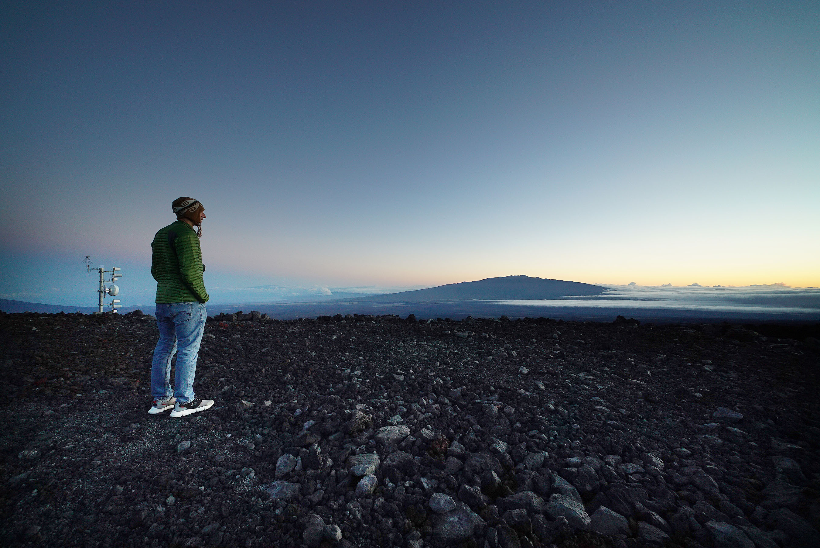 <p><strong>Foundational Science:</strong> Aiden Colton, a NOAA technician at Mauna Loa Observatory, takes a moment to observe Mauna Kea at sunrise. He gathers samples of the clean air atop Mauna Loa for climate scientists to use throughout the world.</p>