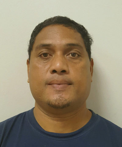 FILE - This Nov. 5, 2016 file photo provided by the U.S. Marshals Service shows James Siugpiyemal, after being taken into custody in Yap in the Federated States of Micronesia. A former inmate who alleges Hawaii officials didn't protect her against Siugpiyemal, a guard convicted of sexual assault is settling a lawsuit for $10,000. The woman's attorney says she reluctantly accepted the nominal amount because the state attorney general's office successfully argued to a judge that the state is immune from a federal lawsuit that doesn't adequately raise constitutional claims. (U.S. Marshals Service via AP, File)