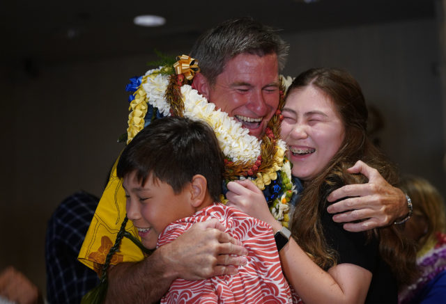 Tommy Waters hugs his son Kai Waters and daughter Emma Waters when results were announced.
