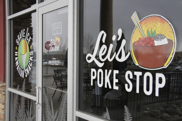"""The exterior of Lei's Poke Stop is seen Wednesday, April 17, 2019, in Anchorage, Alaska. Hawaii lawmakers are considering adopting a resolution calling for the creation of legal protections for Native Hawaiian cultural intellectual property. The move comes after a Chicago restaurant chain owner shocked the island state by trademarking the name """"Aloha Poke"""" and sending letters to similarly named cubed fish shops around the country demanding that they change their names, including this Anchorage store, which changed its name. (AP Photo/Mark Thiessen)"""