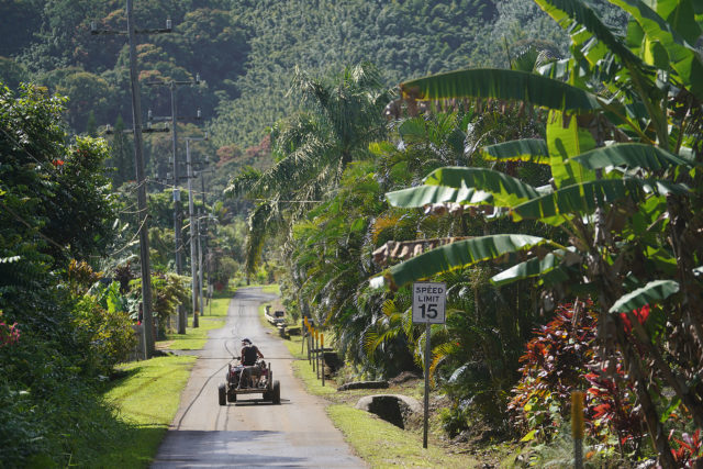 Wailua resident drives his quad down Wailua Road.