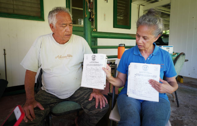 Maui Wailua water Ed and Mahealani Wendt hold some of the original 600 residents' petitions that were signed years ago. The farmers have dwindled to less than 10 people farming kalo or taro in Wailua.