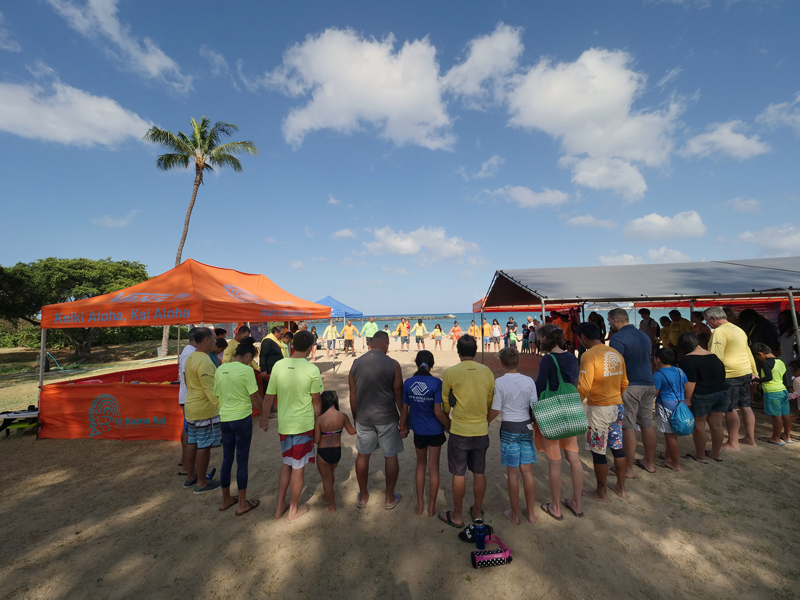 <p>Participants hold hands to pule (pray) before a day of ocean activities. Part of the program&#8217;s mission is to pass on Hawaiian values so members of the next generation will grow up with a sense of how their daily lives affect the environment.</p>