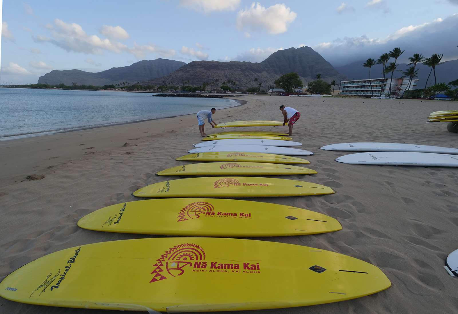 <p>Volunteers for the Na Kama Kai nonprofit organization prepare for a day of ocean safety education by laying out stand-up paddle boards at Poka&#8217;i Bay Beach Park on the Waianae coast on Saturday, April 14.</p>
