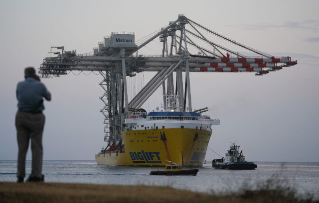 New Matson container cranes arrive at Honolulu Harbor on BigLift ship.