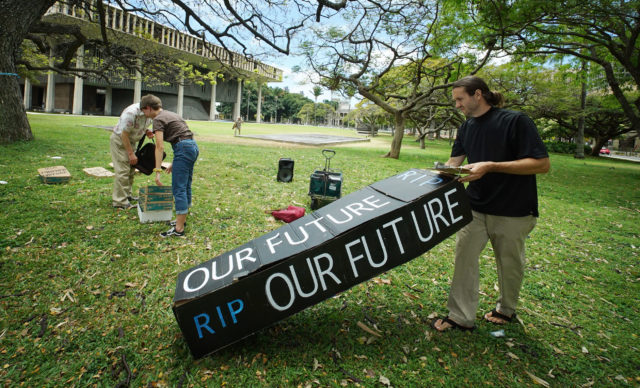 Demonstrators bring their props to an Earth Day demonstration, according to the protestors, over 70 bills died at the legislature.