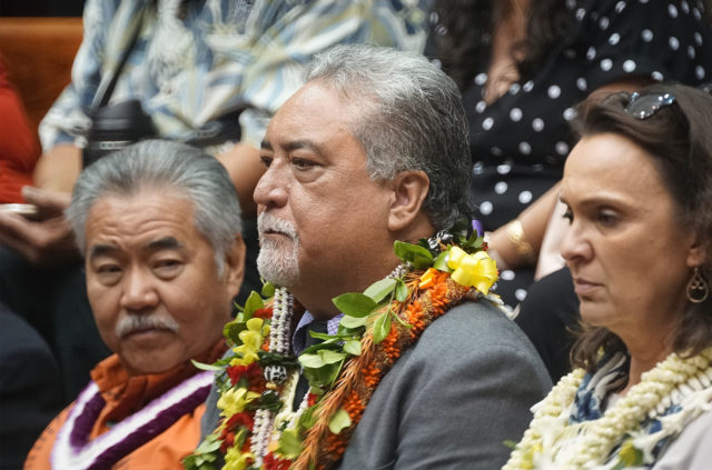 Director Nolan Espinda is confirmed with wife and Governor Ige at his side.