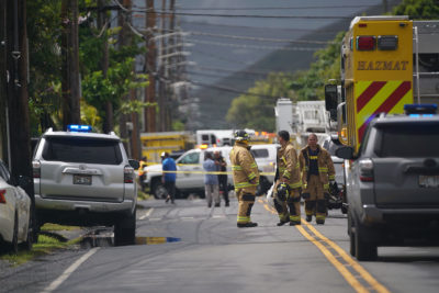 Honolulu Fire Dept personnel along Oneawa Street in Kailua after helicopter crashed in a residential neighborhood.