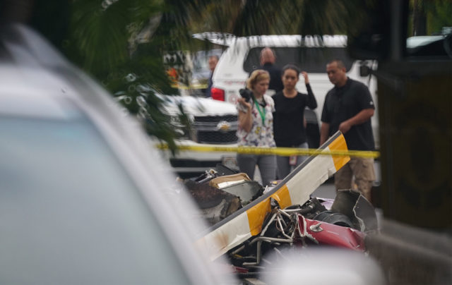 Helicopter debris along Oneawa Street in Kailua after helicopter crashed in a residential neighborhood.