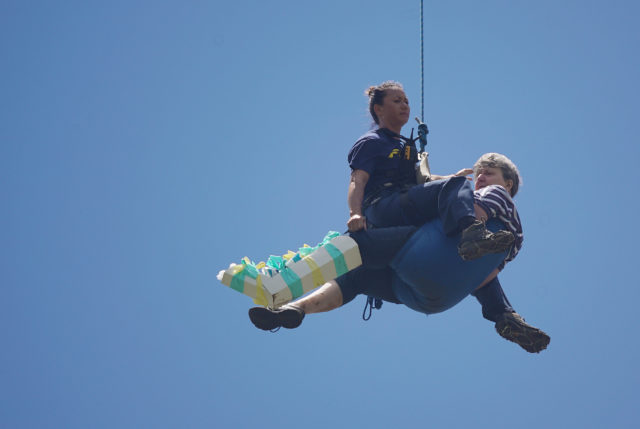 Honolulu Fire Department Rescue Personnel airlifted injured person to an awaiting ambulance at Manoa Recreation Center.