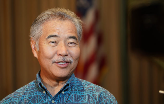 Govenor David Ige beams with smiles saying he is usually a positive person in regards to why he was smiling during press conference.