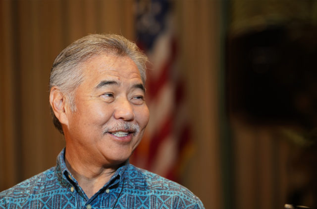 Govenor David Ige beams with smiles.