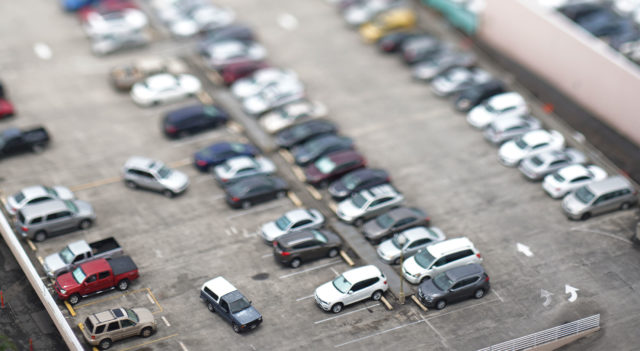 Parking Lot with cars aerial.
